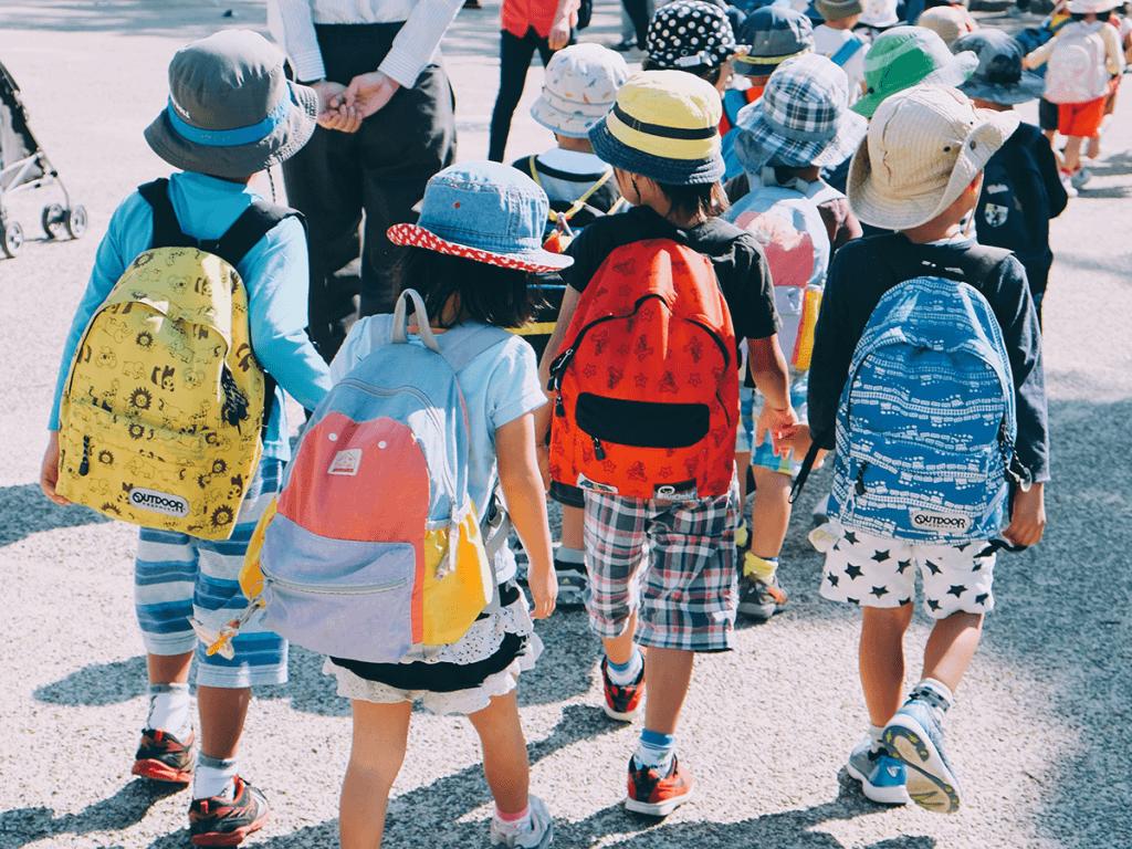 school children walking and wearing backpacks